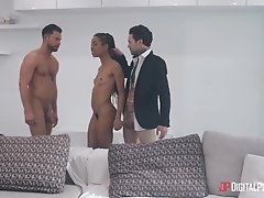Dark-skinned beauty fucks tattooed guy in the living room